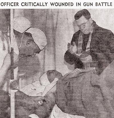 Newspaper photograph: Policeman Huseman being administered last rites at Georgia Street Receiving Hospital